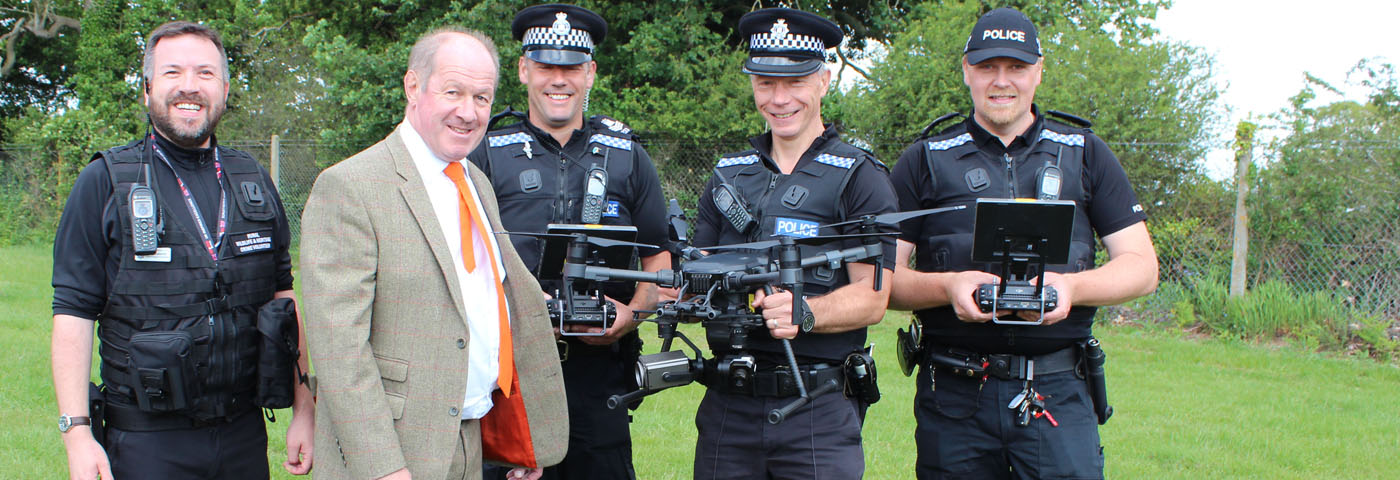 PCC with four rural crime officers holding drones