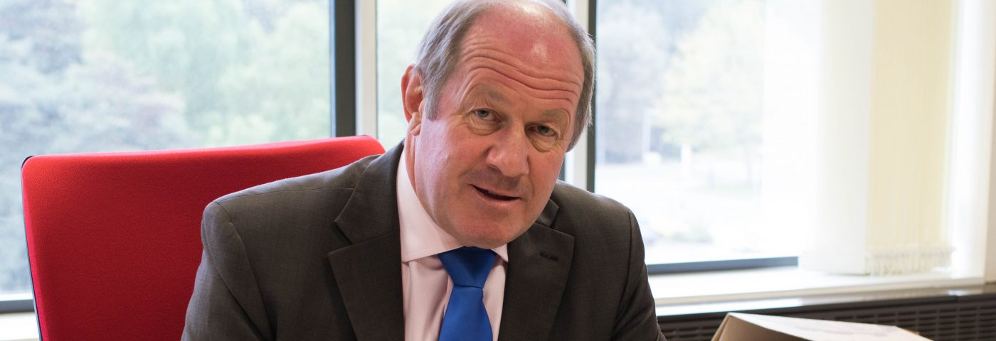 PCC Tim Passmore sitting at his deak